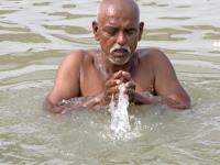 At prayer in the Ganges